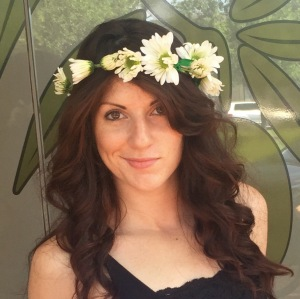 Photo of A Bohem Brunette with a Daisy Chain Around Her Head